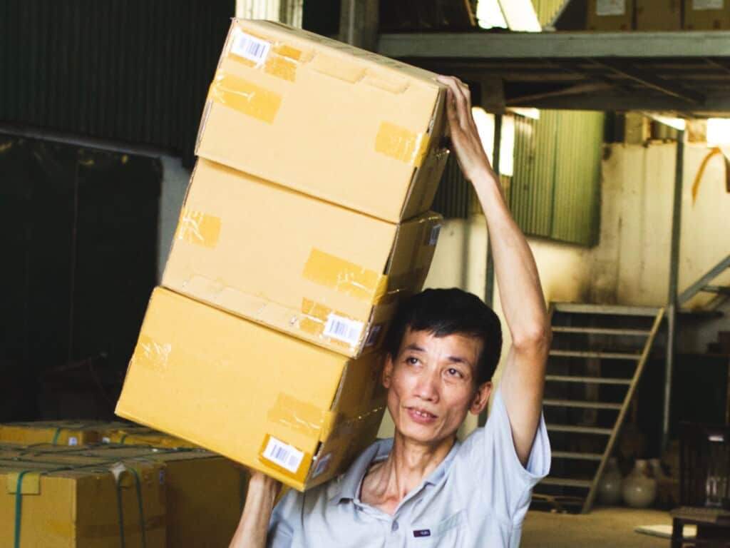 A worker loading cartons to load a container, Vietnam.