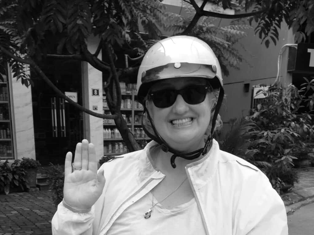 Anita is riding around Hanoi, Vietnam, on her moped (one of her favorite things to do).